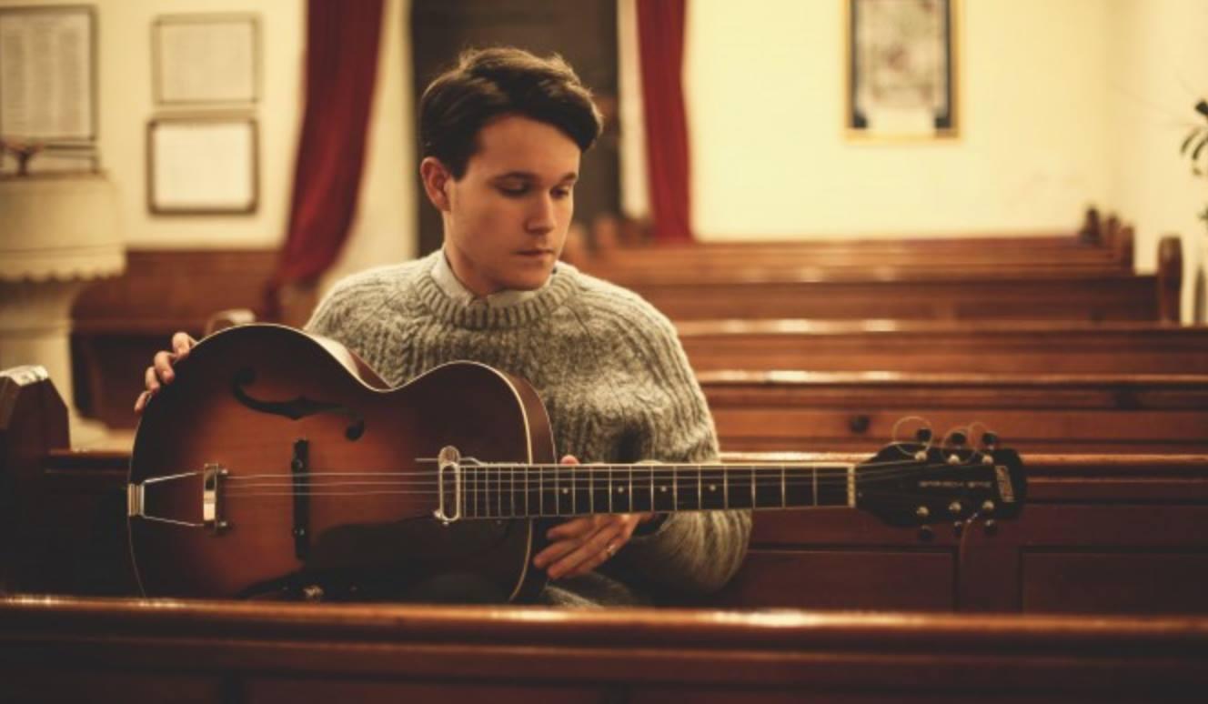 Luke Paul Jackson with guitar
